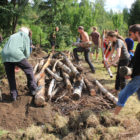A group of people in sweden construct a Hugelculture mound