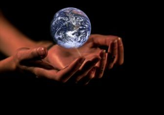 real hands holding earth globe planet world 1920x1359